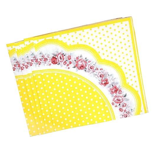 Servilletas de papel amarillo con lunares y suministros ...