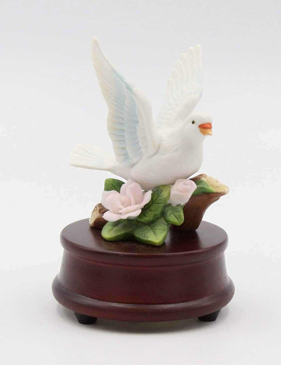 Amazon Com Cosmos Gifts Fine Porcelain Dove With Pink Rose On Wood Base Music Box Figurine 5 H Home Kitchen