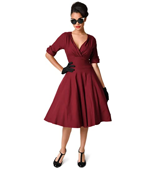 2d5c50a910 Image Unavailable. Image not available for. Color  Unique Vintage 1950s  Burgundy Red Delores Swing Dress with Sleeves
