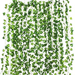 """You will get 12 artificial ivy garland. 80 leaves per piece.Length: approx. 2.1m each, big leaf size: approx. 4.5cm*4.5cm / 1.77""""* 1.77"""", small leaf size: approx. 3.5cm*3.5cm/1.37""""*1.37"""".Leaves were made from silk and the stems were made from..."""