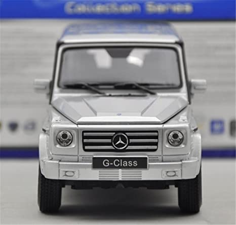 amazoncom welly mercedes g class g55 amg 124 scale pre built diecast model car silver toys games