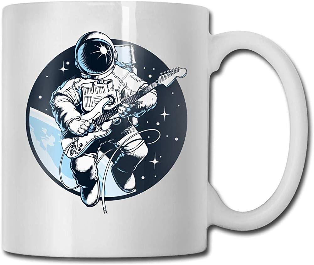 Astronauta tocando la guitarra eléctrica en el espacio Moda Taza ...
