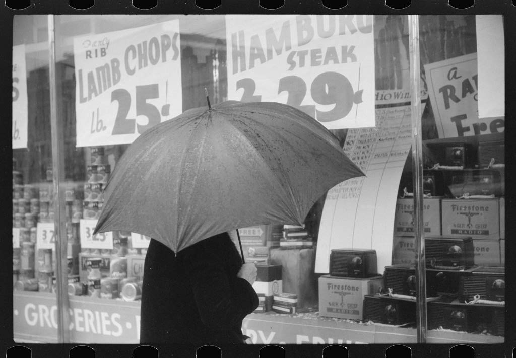 Vintography Reproduced Photo of Woman Window Shopping on a Rainy Day in Norwich, Connecticut 1940 Delano C Jack 48a