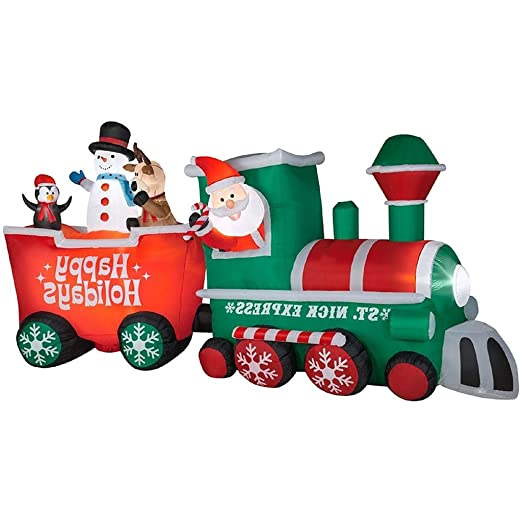 amazoncom christmas inflatable 15 12 st nick express train w conductor santa by gemmy garden outdoor