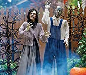 Take your Halloween decorations to the next level with this frightening duo. This woman and man have come back from the dead and are ready to be positioned in your yard to frighten trick-or-treaters. Female Zombie's eyes light up and her head turns s...