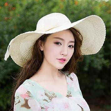 2a643dc99a6 Amazon.com   KIM88 Colorful Big Brim Straw Bow Hat Sun Floppy Wide Brim Hats  Beach Cap Solid Color Big Grass Hat (Beige)   Beauty