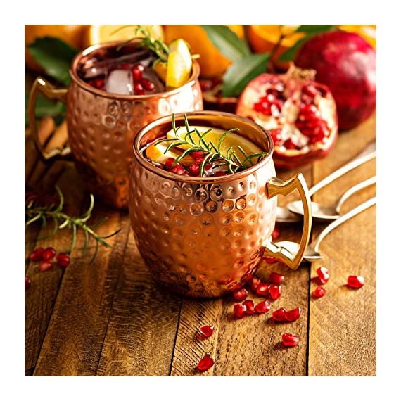 Benicci SYNCHKG100599 Moscow Mule Copper Mugs - Set of 2 16 Ounce Mug with 2 Copper Straws and 1 Jigger, Hammered and Handcrafted 6 ✓ 100% food safe & pure Copper - just like the original 1941 mule: Benicia Copper mugs are not only Authentic but also safe. It went through a comprehensive third party safety and quality tests to make sure that it is food safe. Because we want you to 100% Enjoy your Moscow Mule without worries. ✓ impressive handcrafting - no two are the same: you already know proper handcrafted Moscow mule mugs are as stunning as they are functional. Enjoy your 100% authentic mule cups with a polish finish, you deserve them. ✓ Copper mugs Set of 2 - 12-month Guarantee & gift with purchase: order your Set of 2 Copper mugs today and receive free 2 pure Copper straws and measuring jigger. We're so happy with the craftsmanship on our mugs you get a 12-month money back Guarantee. Order now.