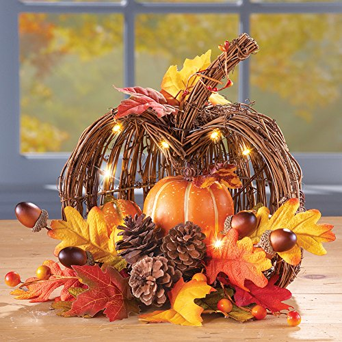 Wicker Pumpkin filled with leaves, berries, acorns, pine cones and lights make a beautiful Thanksgiving centerpiece on the table.