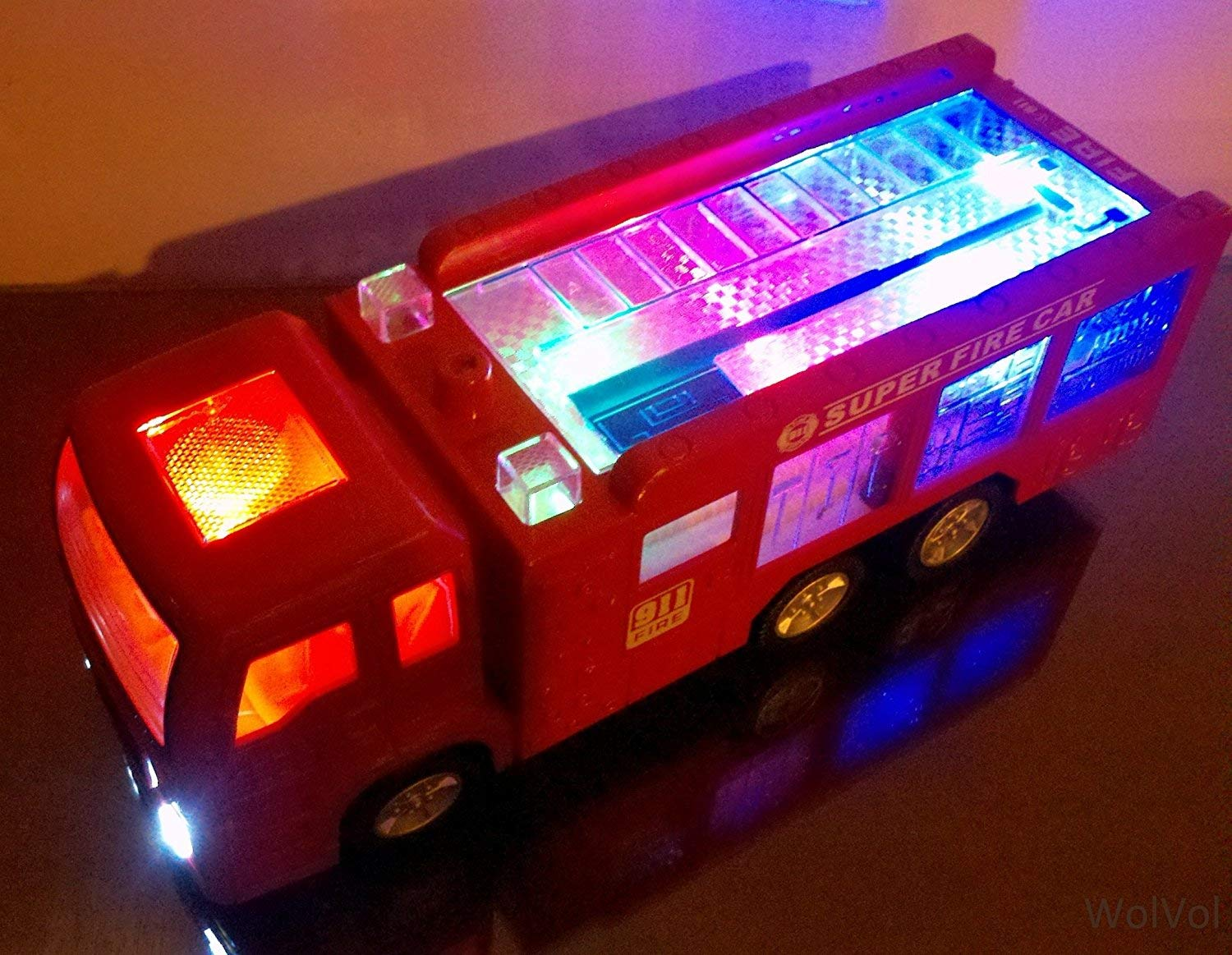 WolVolk Electric Fire Truck Toy with Stunning 3D Lights and Sirens, goes Around and Changes Directions on Contact - Great Gift Toys for Kids