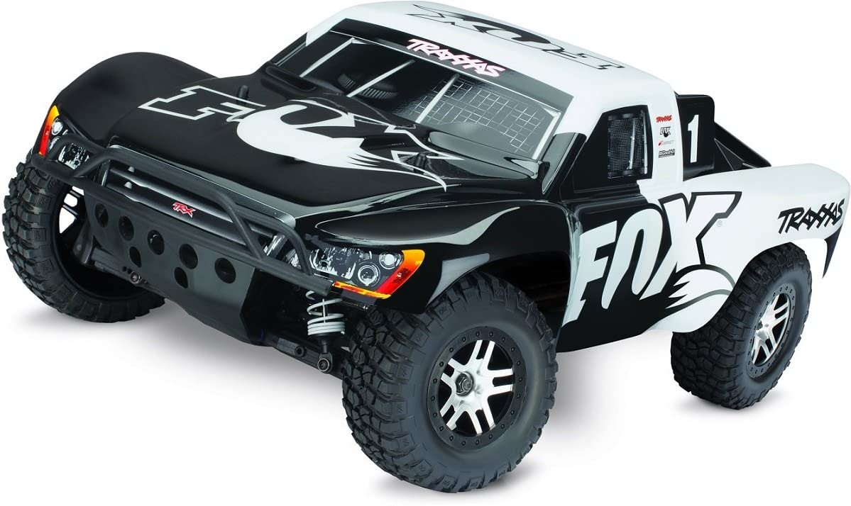 Amazon Com Traxxas 68086 4 Slash 4x4 1 10 Scale 4wd Short Course Truck With Tqi 2 4ghz Radio And Tsm Fox Toys Games