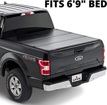 Amazon Com Leer Hf350m Fits 1999 2016 Ford Super Duty With 6 9 Ft Bed Low Profile Easy On Off Hard Tri Fold Truck Bed Tonneau Cover Automotive