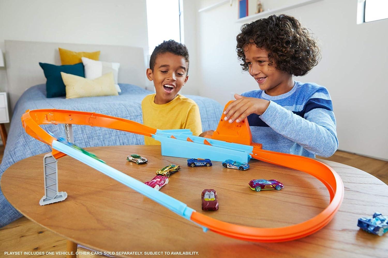 GJM75 une petite voiture de course incluse piste ovale avec propulseur Hot/Wheels Action Coffret La Piste des Champions jouet pour enfant