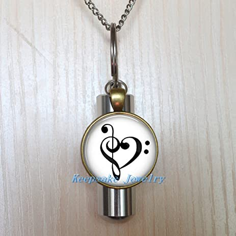 Amazon treble and bass clef heart urn necklace jewelry treble and bass clef heart urn necklace jewelry cremation necklace jewelry ashes necklace jewelry aloadofball Choice Image