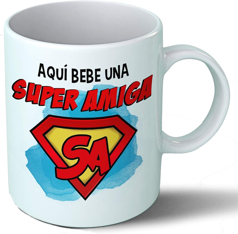 Planetacase Taza Amiga - Aquí Bebe Una Super Amiga - Regalo Original Amigas Superamiga Familia Taza Desayuno Café Ceramica 330 mL
