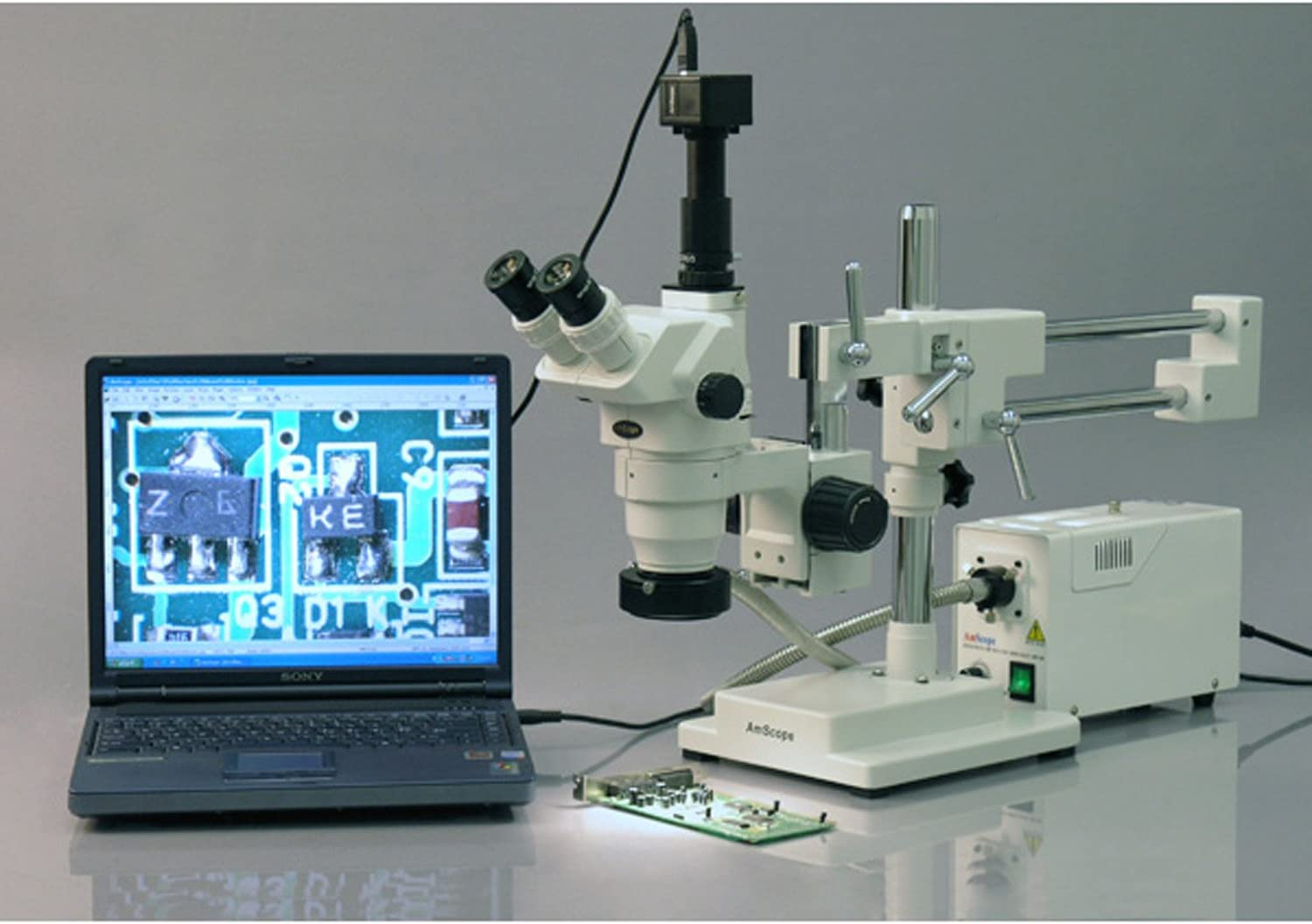 Includes 0.3x and 2.0x Barlow Lenses AmScope ZM-4TZ3 Professional Trinocular Stereo Zoom Microscope 0.67X-4.5X Zoom Objective 2X-90X Magnification Ambient Lighting Double-Arm Boom Stand EW10x Eyepieces