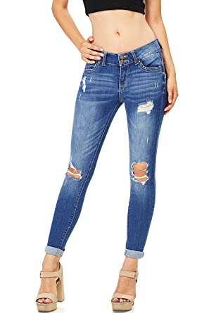 a18d3e3ae869 Wax Women's Juniors Mid Waist Knee Rip Skinny Jeans at Amazon Women's Jeans  store
