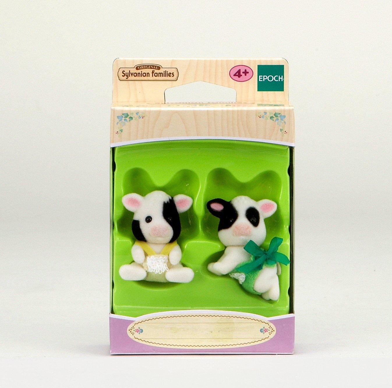 Sylvanian Families 3557 - Figuras de terneros gemelos, color blanco y negro con lazo amarillo y verde: Amazon.es: Juguetes y juegos
