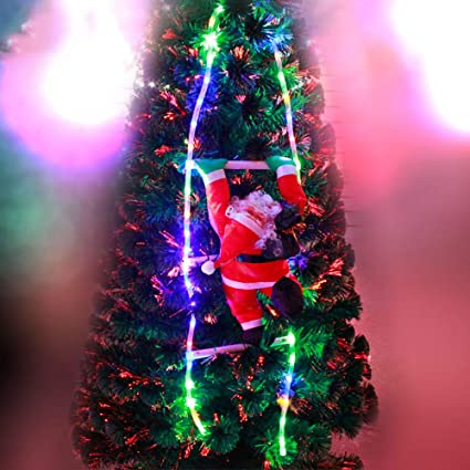 joint santa claus climbing stairs on ladder christmas decoration lights christmas figure christmas tree wedding party