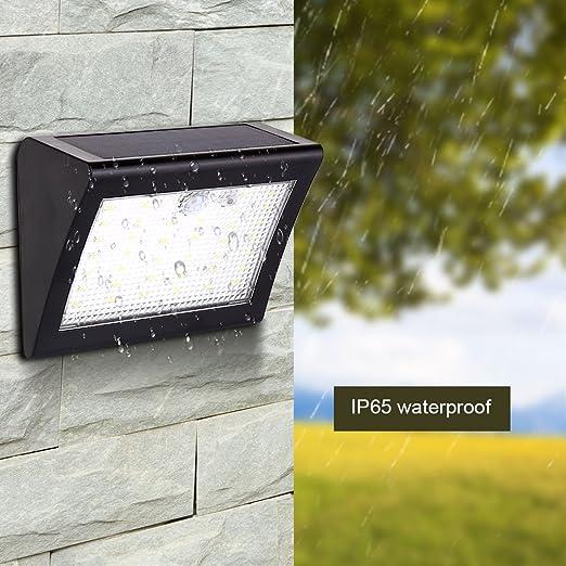 Focos Solares Exterior, Luz Solar Jardín 38 LED, Luces de Exterior con Sensor de Seguridad por Movimiento Inalámbricas y con Batería Solar para Muros Exteriores, Jardines, Patios y Terrazas: Amazon.es: Jardín