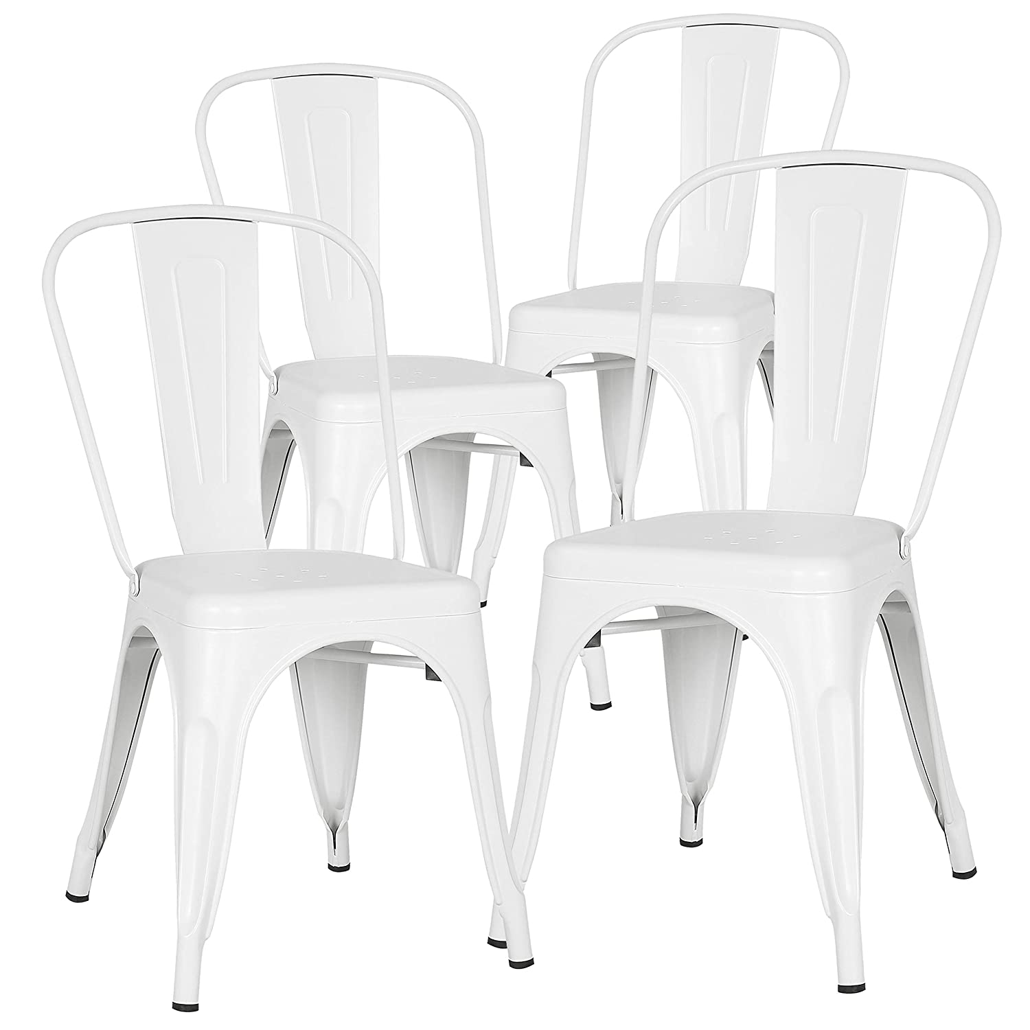 White Tolix style French industrial metal farmhouse dining chairs.