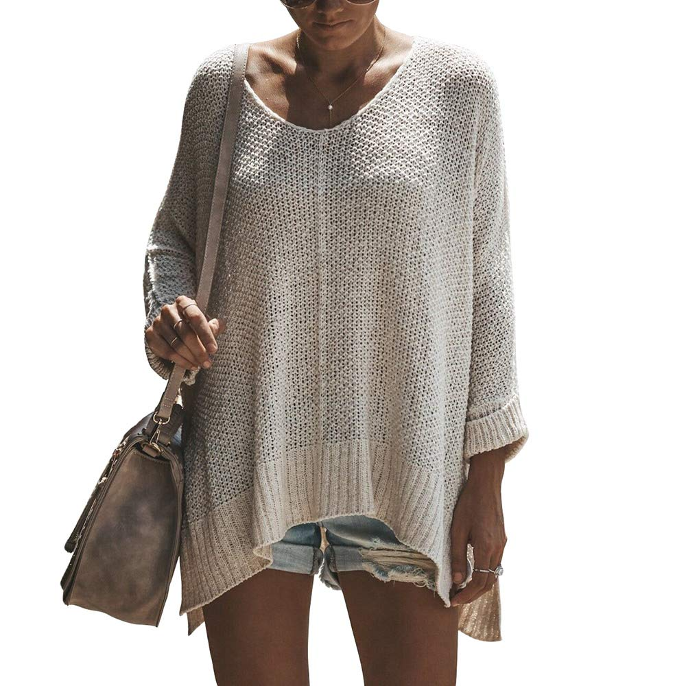 609b13efcc4ee6 This loose oversized pullover sweater is a little see-through