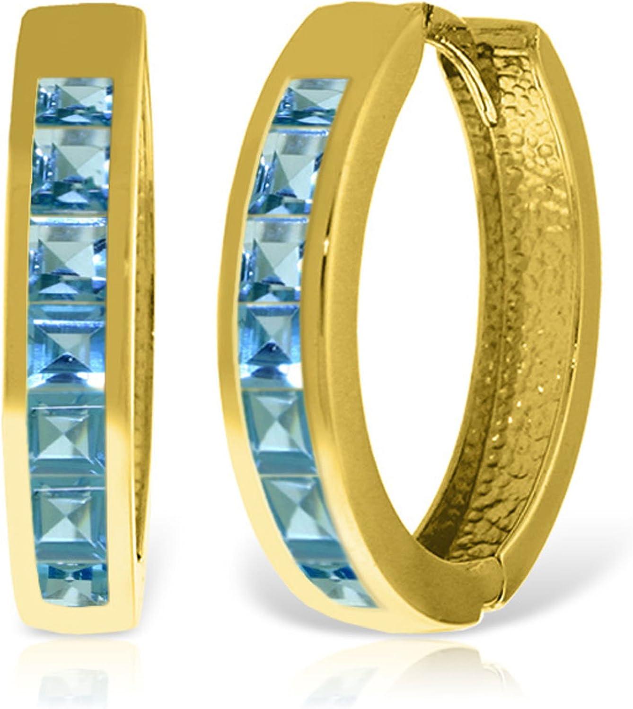 Galaxy Gold 14k Solid Gold Hoop Huggie Earrings with Blue Topaz