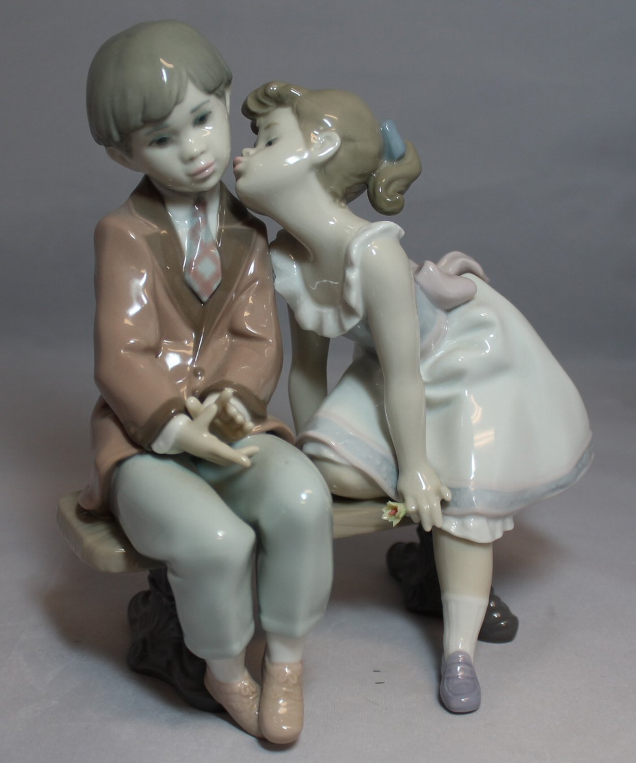 Lladro ''Ten and Growing'' #07635....Brand New in Original Box....Stamped under the base with the Lladro Logo #7635 and ''10th Anniversary LCS 1985/1995''...this lovely figurine measures 7 1/2'' long by 8'' tall...