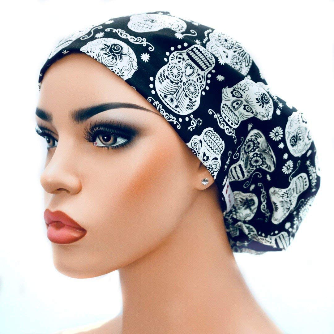 Womens Adjustable Bouffant Surgical Ponytail Cap Black with Glow in the Dark Skulls by DK Scrub Hats