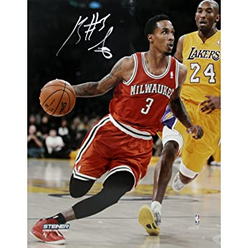 2123e872523 NBA Milwaukee Bucks Brandon Jennings Drives Passed Kobe Bryant Signed  Photograph