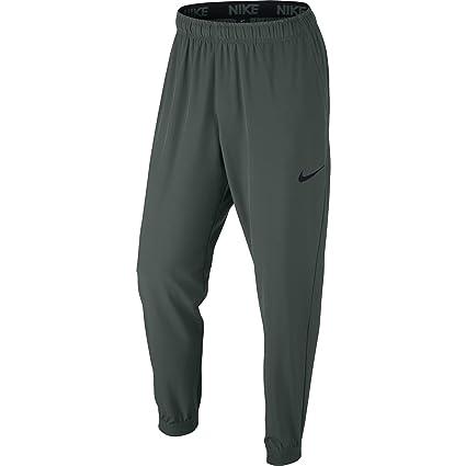 e6e206880b57f Amazon.com  NIKE Men s Flex Training Pants Vintage Green Black Black ...
