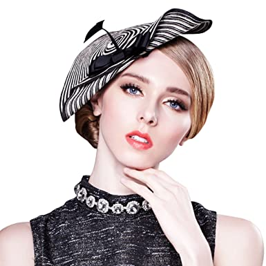 02346615f941 Womens Chic Straw Arrow Fascinator Cocktail Saucer Hat Royal Ascot Wedding  A003 (Black and White)(Size  One Size)  Amazon.co.uk  Clothing