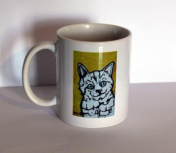 El gato Tazas de cerámica. Técnica serigrafía. Dibujo original creado por davide pacini.