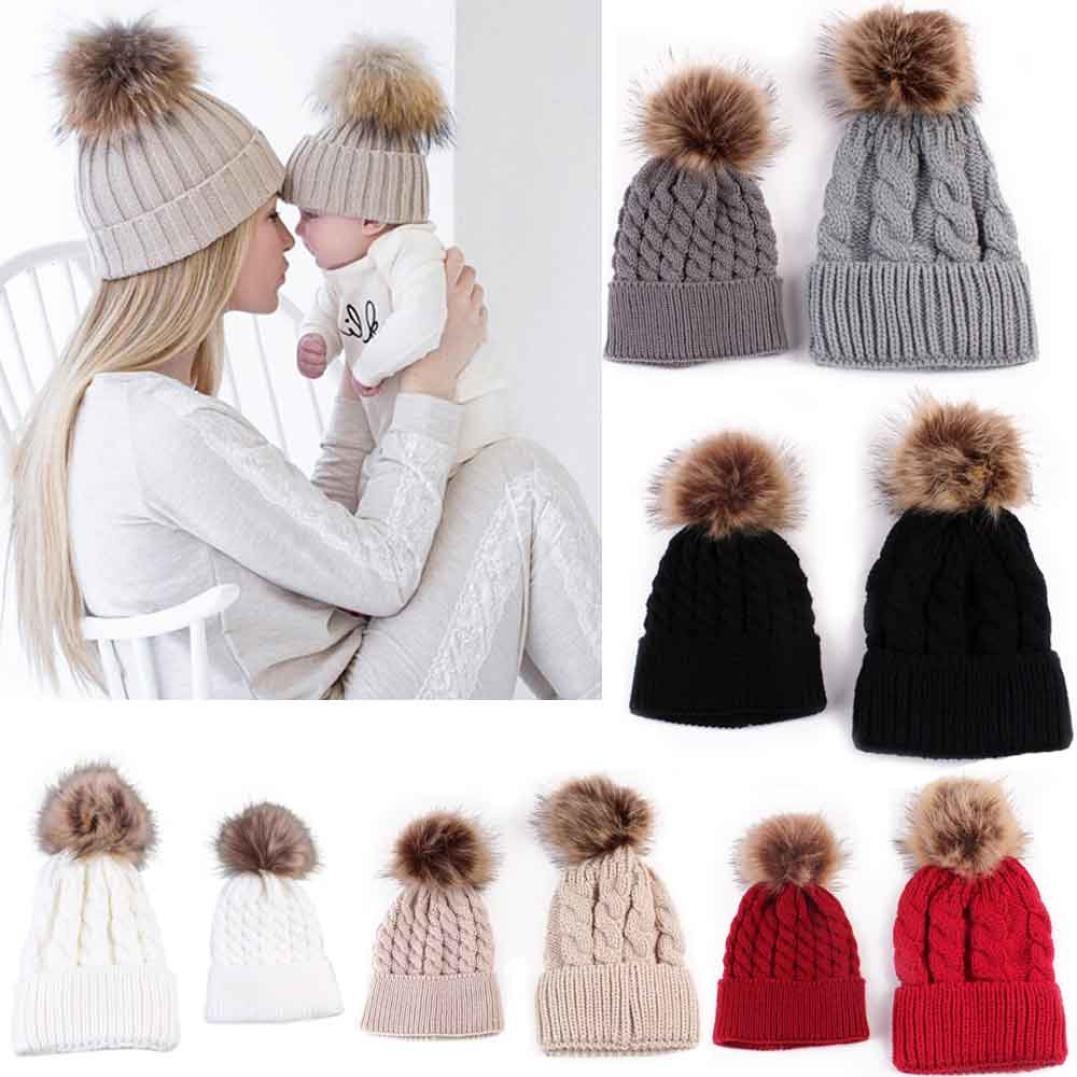 c703cff6f25 Amiley Mom and Baby Knitted Crochet Fur Pom Pom Hat Braided Warm Ski Beanie  Cap (Black) at Amazon Women s Clothing store