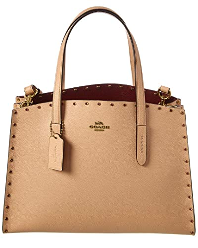 Amazon.com: COACH Charlie Carryall - Remaches para mujer ...
