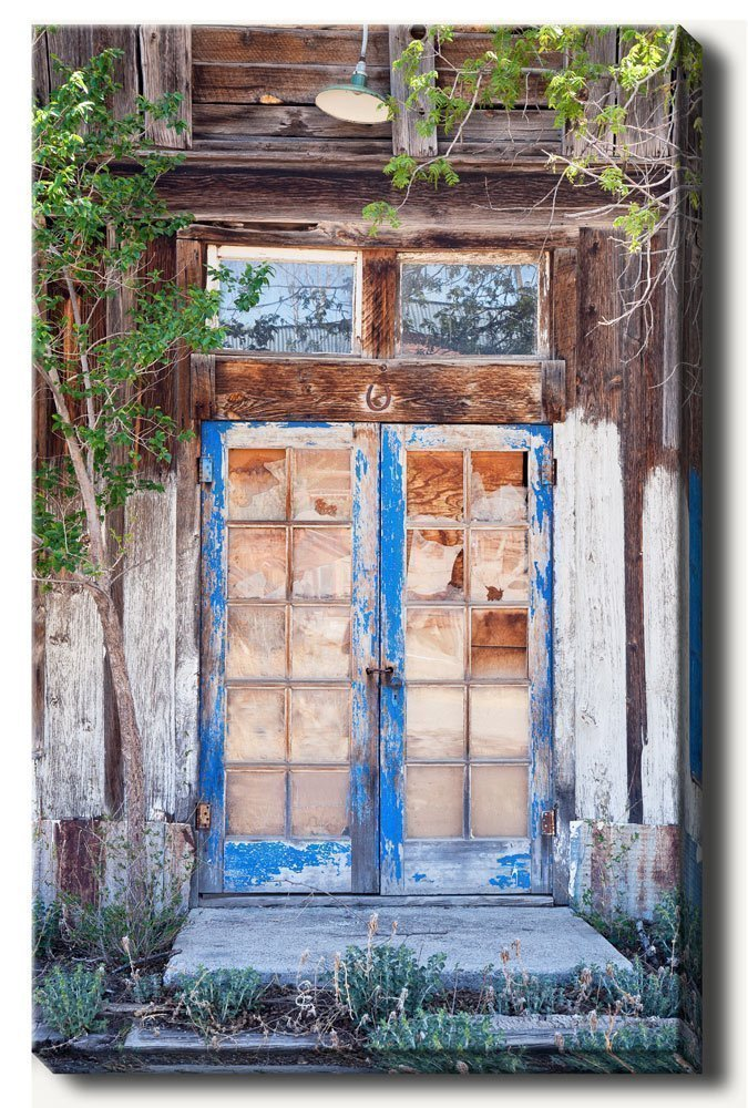 16 x 24 inch gallery wrapped canvas photograph of a well worn blue door at abandoned home at a ghost town. Wall art décor photography that would make a great gift for your girlfriend.