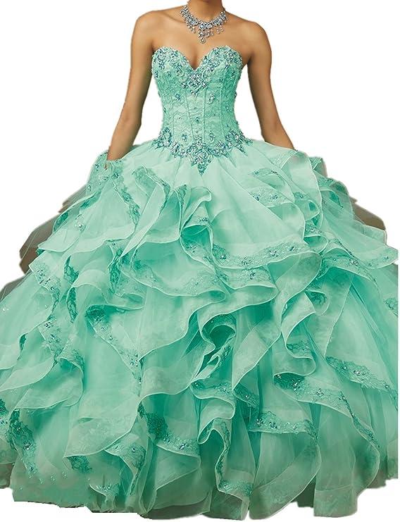 086a3949e Este vestido está confeccionado con una falda de organza con volantes hasta  el piso y forro interno