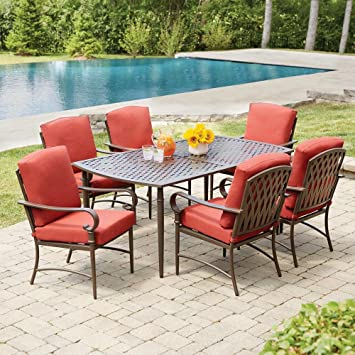 Delightful Oak Cliff 7 Piece Metal Outdoor Dining Set With Chili Cushions