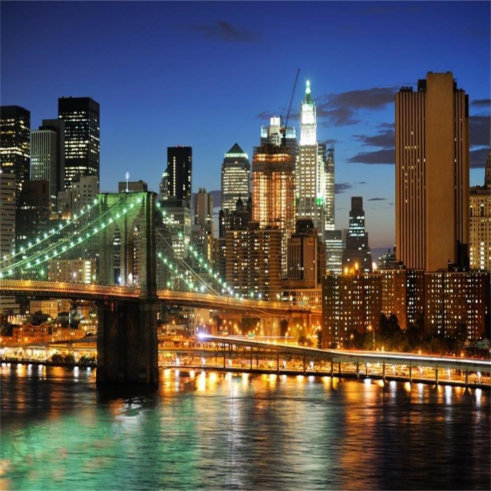 AOFOTO 8x8ft New York City Brooklyn Bridge Background Downtown Skyscrapers at Night Photography Backdrop Manhattan Skyline Hudson River Man Adult Portrait Business Photo Studio Props Vinyl Wallpaper