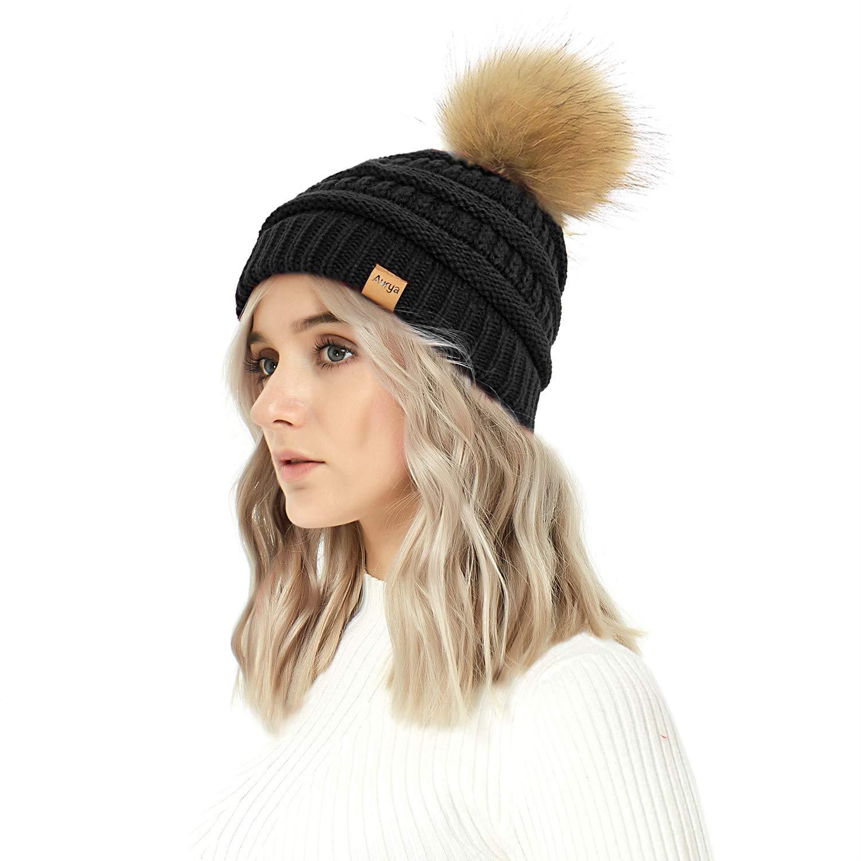 c68b56b58a9 Aurya Cable Knit Pom Pom Beanie Womens Winter Warm Faux Fur Pompoms Bobble  Ski Hat Cap Black at Amazon Women s Clothing store