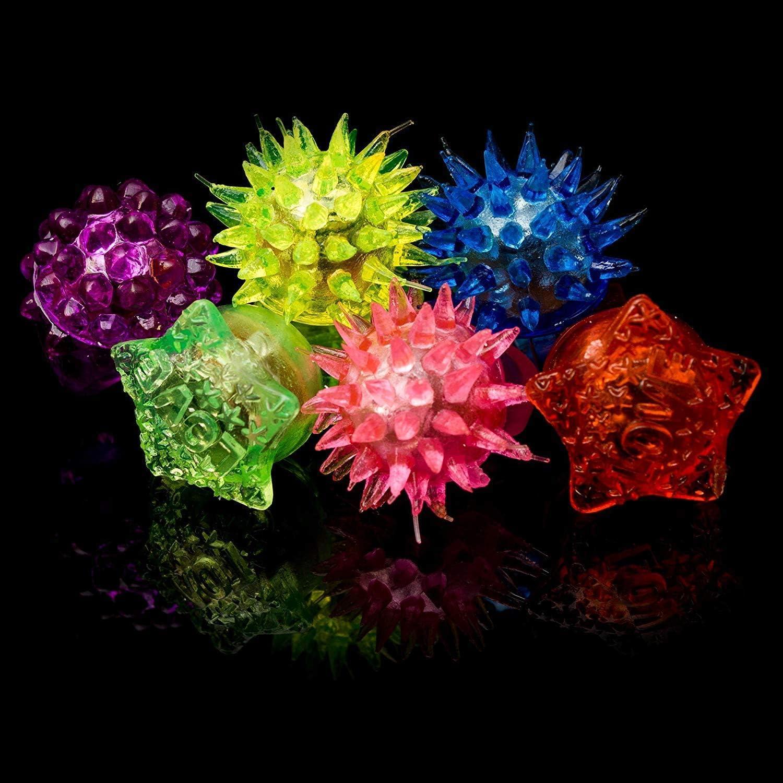 dazzling toys Flashing LED Multi Color Flower Finger Rings 12 Pack