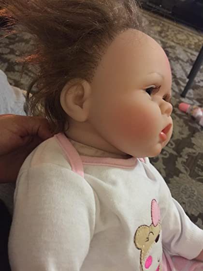 Kaydora Reborn Baby Doll Girl 22 Inch Lifelike Real Baby Doll Reborn, Named Lucy Horrible looking doll it looks like Chuckey