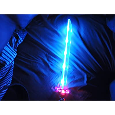 Deluxe Ninja LED Light up Sword with Motion Activated Clanging Sounds: Office Products