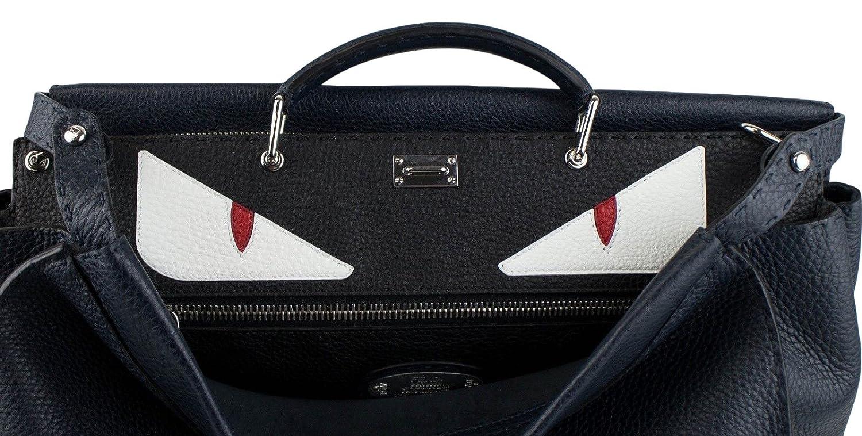 2fe219a640de Amazon.com   Fendi Men s Navy Blue Leather Peekaboo Selleria Handbag with  Monster   Baby