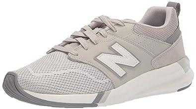 bcaa2d98853 New Balance Women's 009 V1 Sneaker Light Cliff Grey 10 B US