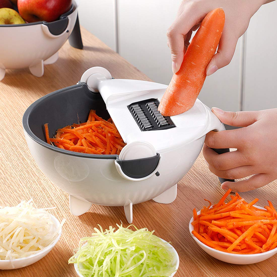 A rotate vegetable peeler is used to grind carrot along with others