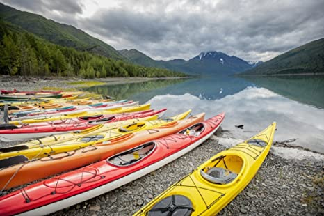 Remsberg Inc / Design Pics – Kayaks in a row on shore at Eklutna Lake Chugach