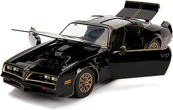 30998 Modelo Coche DieCast 1977 Pontiac Firebird con r/éplica de la Hebilla de Smokey Bandit Los Caraduras Multicolor Scala 1//24 20cm Jada