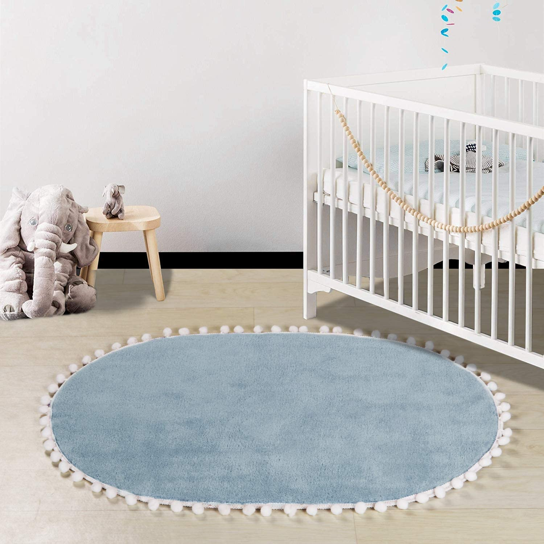 LEEVAN Faux Wool Area Rug Cute Pom Pom Fringe Nursery Rug Baby Crawling Mat Kids Play Non-Slip Floor Carpet for Living Room Bedroom Sofa Oval Round Rugs, 2 x 3 ft-Light Blue