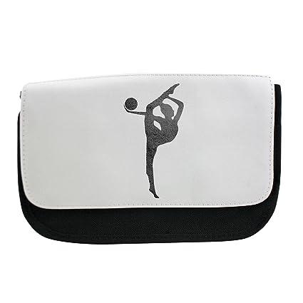 Una niña que hace bola de gimnasia rítmica en negro y blanco ...