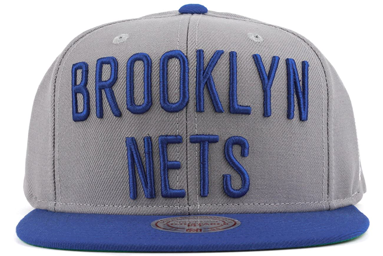 quality design e4c61 0bcbf Amazon.com  Brooklyn Nets Mitchell   Ness XL Logo 2 Tone Snapback Hat  -Blue Grey  Clothing